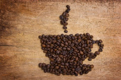 Beeld een kop van koffie die van bonen wordt gemaakt Stock Afbeeldingen