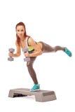 Beeld van aantrekkelijk meisje belast met aerobics Stock Afbeeldingen