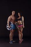 Beeld van atleten die met sportuitrusting stellen Royalty-vrije Stock Fotografie