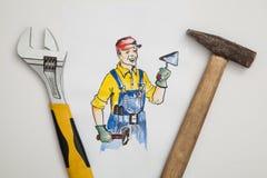 Beeld van bouwer met hulpmiddelen Stock Afbeeldingen