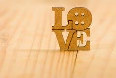 Beeld van de inschrijving van liefde als symbool van liefde en toewijding stock foto