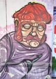 Beeld van de man op de muur Stock Foto