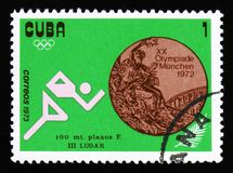 Beeld van een atletenagent, met de inschrijvingssprint 100 m van reeks XX de Zomerolympische spelen, München, 1972, circa 1973 Stock Fotografie