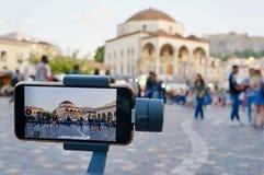 Beeld van een video in Athene wordt geregistreerd dat stock fotografie