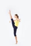 Beeld van flexibel jong mooi meisje die verticale spleet doen Royalty-vrije Stock Foto's