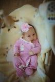 Beeld van leuk meisje in roze kostuum binnen Stock Afbeeldingen