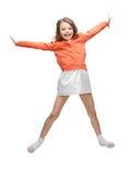 Springend meisje in vrijetijdskleding Stock Fotografie