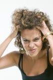 Beeld van ongerust gemaakte vrouw die haar haar houdt Royalty-vrije Stock Fotografie