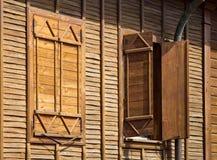 Beeld van Oude houten vensters met blinden Stock Foto's