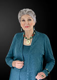 Beeld van oudere vrouw met multi gekleurde halfedelreeks stock foto's