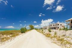 Beelden van verlaten huizen alon het strand Stock Foto's