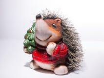 Beeldje van een Egel in Kerstmis rode sweater met een Christma Stock Afbeelding