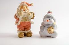 Beeldje van Santa Claus en een Sneeuwman (Kerstmisthema) royalty-vrije stock afbeelding