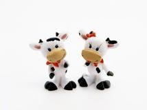 Beeldjes van stier en koe stock fotografie