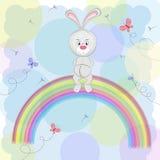 Beeldverhaal een leuke gelukkige konijnzitting op de regenboog Vector Illustratie