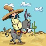 Beeldverhaal Mexicaan die een ezel in de woestijn berijdt Stock Fotografie