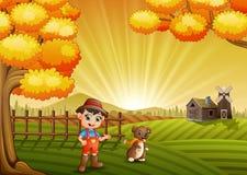 Beeldverhaal weinig landbouwer met zijn hond op de landbouwbedrijfachtergrond stock illustratie