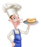 Beeldverhaalchef-kok With Hot Dog Stock Foto's