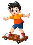 Beeldverhaaljongen het spelen skateboard stock illustratie