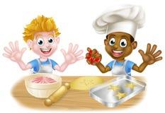 Beeldverhaaljongens die Cakes bakken Royalty-vrije Stock Afbeeldingen