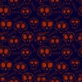 Beeldverhaalschedels in blauw en oranje, het naadloze patroon van Halloween, vector Stock Foto