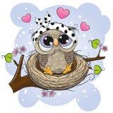 Beeldverhaaluil in een nest op een tak stock illustratie