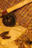 Been fishing, angling. Vintage fishing creel with been fished tackle, vest, fly rod & reel Royalty Free Stock Images