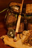 Been fishing, angling. Vintage creel with trout amidst grass, been fished vest, lures, fly rod & reel Stock Photography