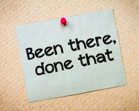 Been there, done that. Message. Recycled paper note pinned on cork board. Concept Image Stock Photo
