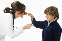 Beep. Young female doctor having a sweet approach with a little boy royalty free stock photos