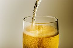 Beer. Being poured into a glass Stock Images