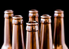 Beer. An open beer bottle, black background isolated Stock Photo