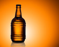 Beer. Bottle beer on become red background Royalty Free Stock Photography