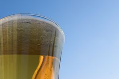 Beer. Glass against a blue sky background royalty free stock photos