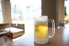Glass of beer. On the table stock photo