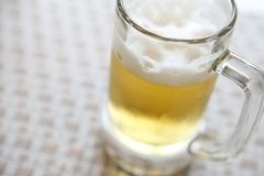 Glass of beer. In close up stock photography