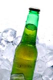 Beer. Green bottle of beer with waterdrops stock image