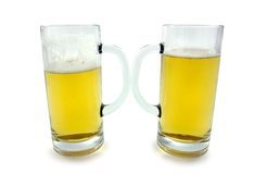 Beer. Two mugs of beer. Clipping path included Royalty Free Stock Photography