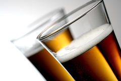 Beer. Close up of two glasses of beer Royalty Free Stock Photography