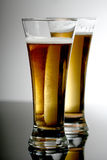 Beer. Two glasses of beer on dark background Stock Photo