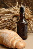 Beer. Bottle of beer and bread Stock Photo