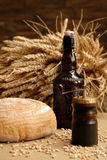 Beer. Bottle of beer and pepper mill Royalty Free Stock Photos