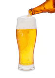 Beer. Pouring Beer isolated on a white background Stock Image