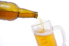 Beer. From a bottle poured into a glass royalty free stock image
