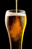 Beer. Part of a glass of cold beer is a light froth Stock Photo
