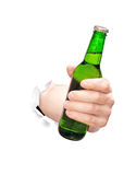 Beer. In hand brake trough white paper Stock Photos