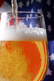 Beer. Cold beer macro and the American flag Stock Photography