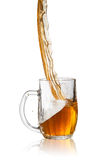 Beer. Pouring beer into glass, isolated on white background Stock Photo