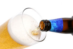Beer. Pouring beer stock photography