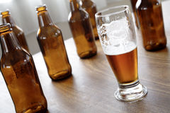 Beer. In glass and empty bottles Stock Image